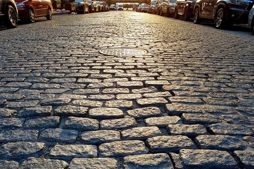 Brick pavement and cars