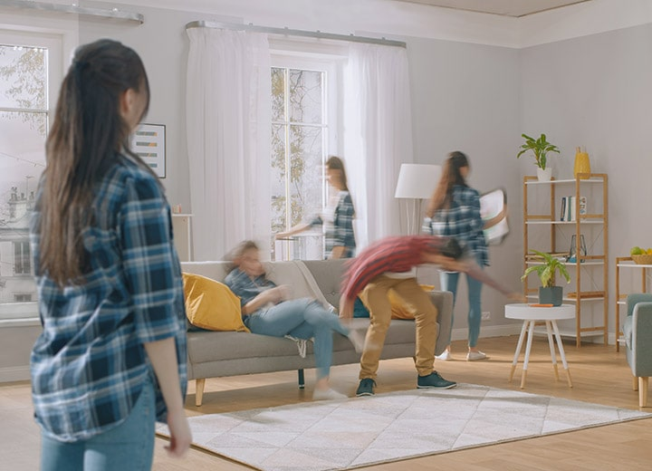 a family trying to rearrange furniture by themselves